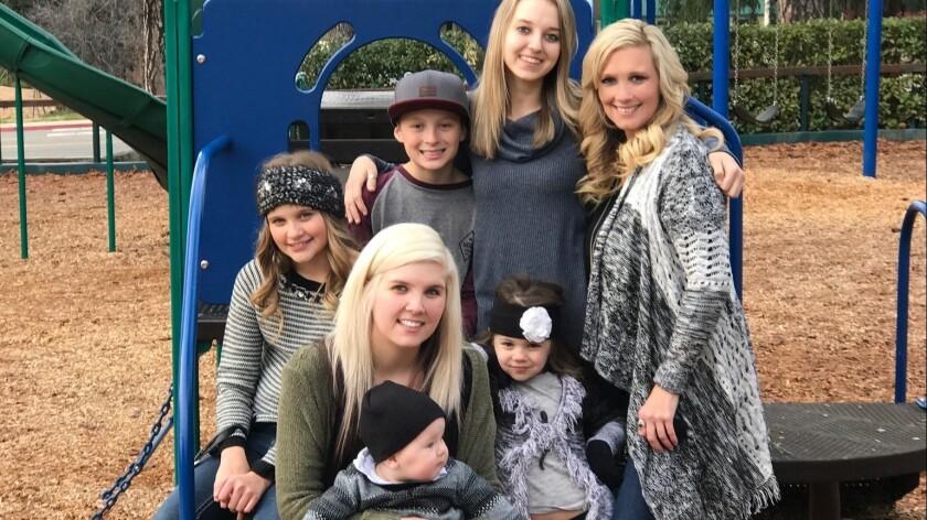 Tamara Ferguson, right, with her five children. Allyson, Clarissa (holding her son Korbin), Brayden,