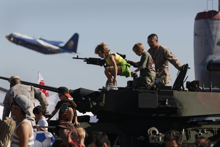 Kids got to climb on light armored vehicles at the 2012 Miramar Air Show, while flight demonstrations continued all day.