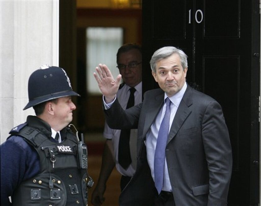 FILE - This Wednesday, May, 12, 2010 file photo shows Britain's Liberal Democrat Chris Huhne wave for photographers as he arrives at the official residence of Prime Minister David Cameron at 10 Downing Street in London. England's chief prosecutor said Friday Feb. 3, 2012, Energy Secretary Chris Huhne, a leading Cabinet minister, has been charged with attempting to dodge a speeding penalty, casting his political career into doubt. (AP Photo/Akira Suemori, File)