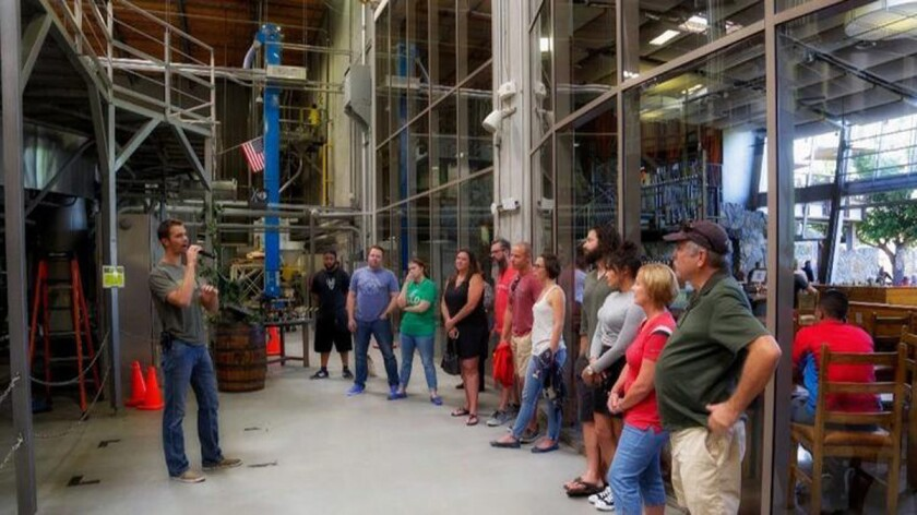A group tours Stone, North County's largest brewery. ((Nelvin Cepeda/The San Diego Union-Tribune))