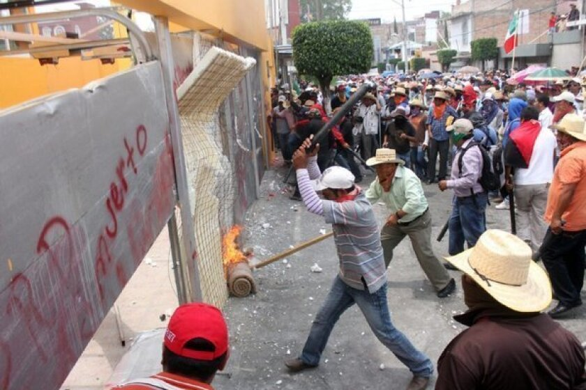 Angry teachers take a break, but threats to Mexican reform remain