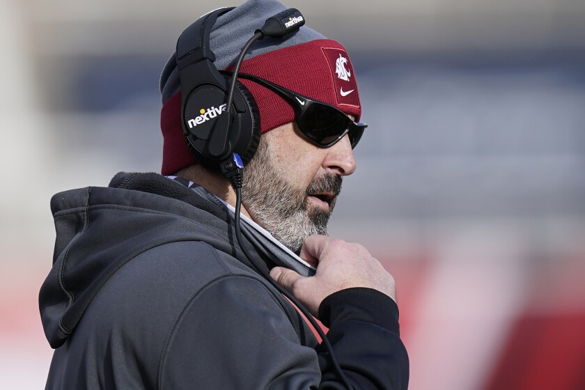FILE - Washington State head coach Nick Rolovich looks on during the first half of an NCAA college football game against Utah in Salt Lake City, in this Saturday, Dec. 19, 2020, file photo. Rolovich has become the story of Pac-12 media day even though he won't be in attendance. Rolovich's announcement last week he has chosen not to receive a COVID-19 vaccination has divided his fan base and seemingly his school as one of the colleges requiring students and staff to be vaccinated before the start of classes this fall. (AP Photo/Rick Bowmer, File)