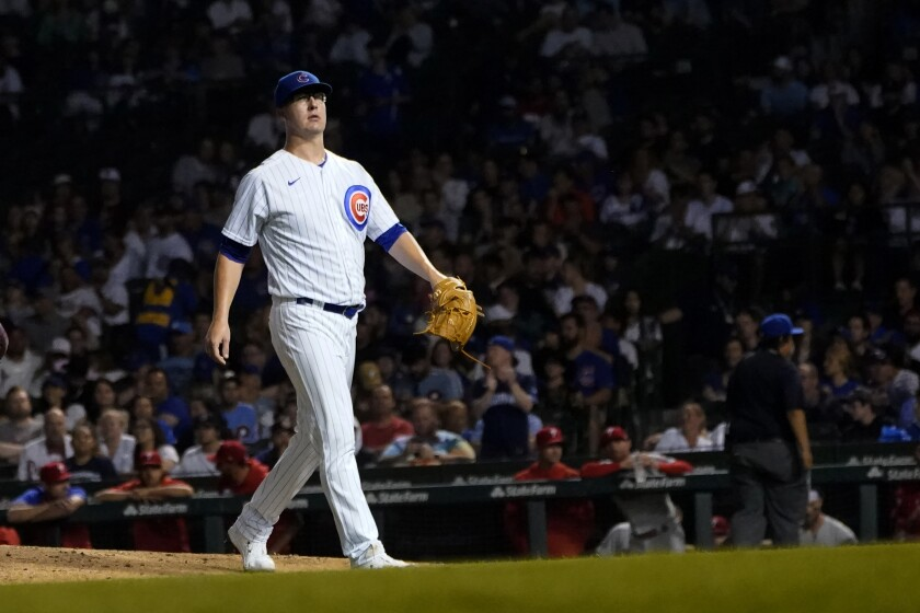 Chicago Cubs starting pitcher Alec Mills leaves the baseball game during the sixth inning against the Philadelphia Phillies on Wednesday, July 7, 2021, in Chicago. (AP Photo/Charles Rex Arbogast)
