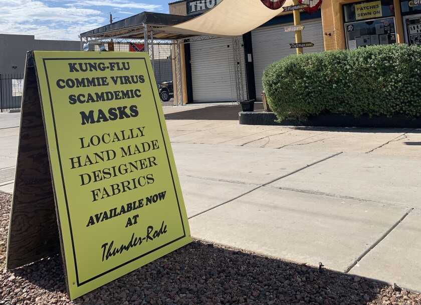 "A sign outside Thunder-Rode motorcycle accessories store in Kingman, Ariz., touts ""Kung-Flu Commie Virus Scamdemic Masks."""