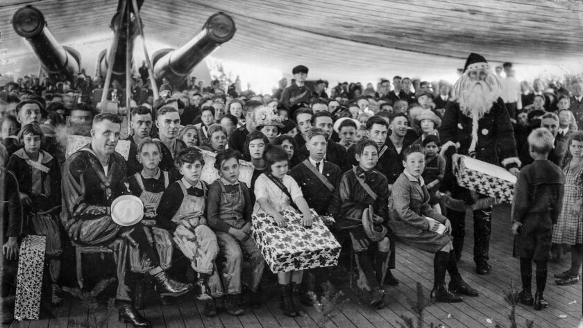 Dec. 25, 1922: Santa Claus distributes presents on board the battleship California as 100 children – guests from local charities – attend a party.