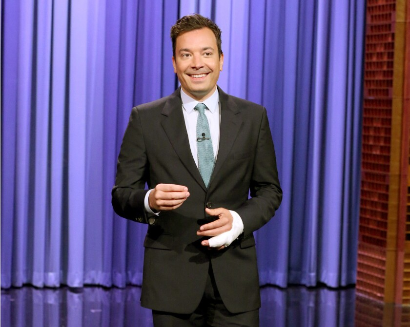 "Host Jimmy Fallon appeared on ""The Tonight Show Starring Jimmy Fallon"" last July with his left-hand ring finger bandaged."