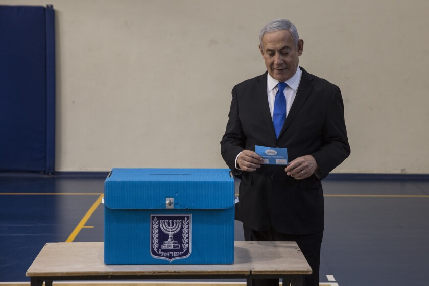 Israeli Prime Minister Benjamin prepares to vote at a voting station in Jerusalem on September 17, 2019. Israelis began voting Tuesday in an unprecedented repeat election that will decide whether longtime Prime Minister Benjamin Netanyahu stays in power despite a looming indictment on corruption charges. (Heidi Levine, Sipa, Pool via AP).