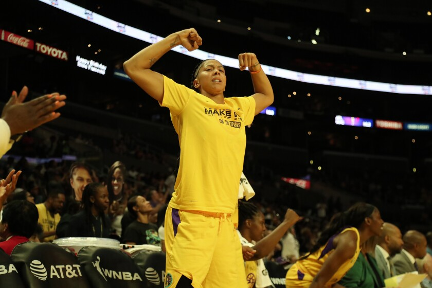 Sparks forward Candace Parker reacts from the bench during Sunday's playoff win over the Seattle Storm.