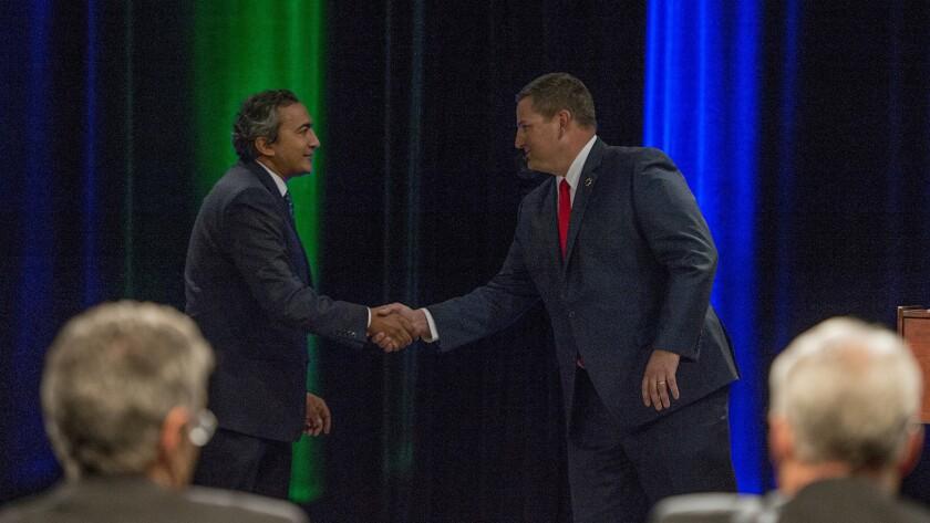 Democratic U.S. Rep. Ami Bera, left, shakes hands with his Republican challenger, Sacramento County Sheriff Scott Jones.