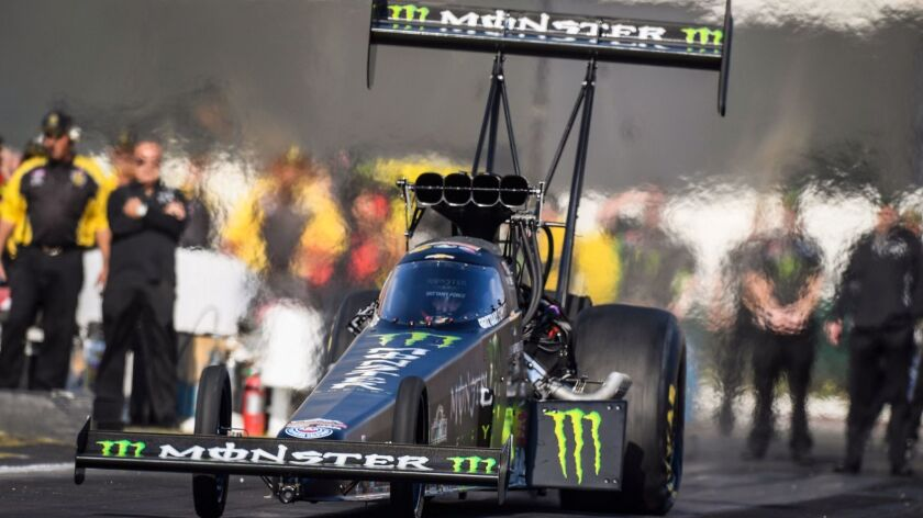 In this photo provided by the NHRA, Brittany Force drives in Top Fuel qualifying Friday, Nov. 10, 20