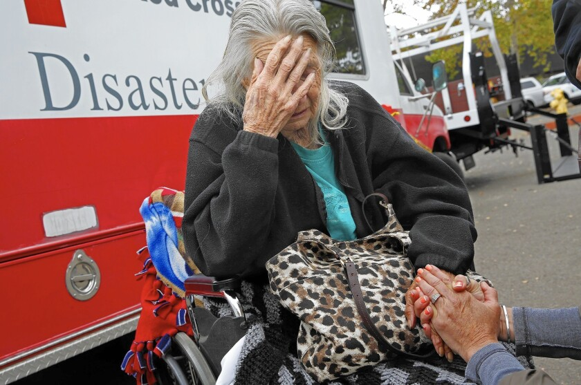Winnie Pugh was evacuated from her home by her sons after she refused to go with firefighters.