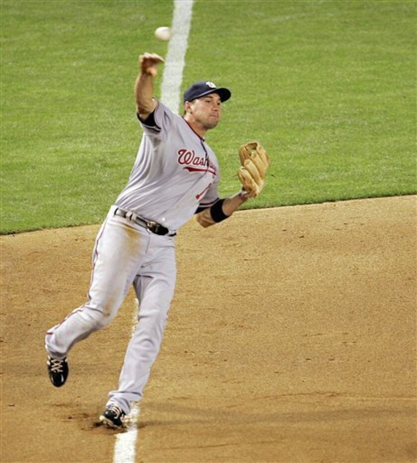 Washington Nationals third baseman Ryan Zimmerman throws out Arizona Diamondbacks' Josh Wilson during the sixth inning of an MLB baseball game Friday, May 8, 2009 in Phoenix. (AP Photo/Matt York)