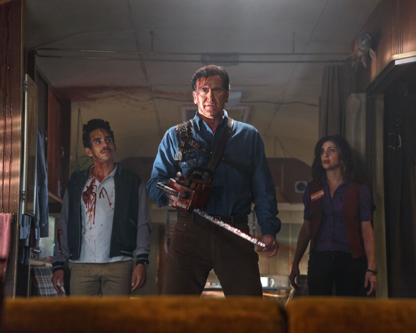 """Ray Santiago (as Pablo), Bruce Campbell (as Ash) and Dana DeLorenzo (as Kelly) appear in a scene from the Starz series """"Ash vs Evil Dead."""""""