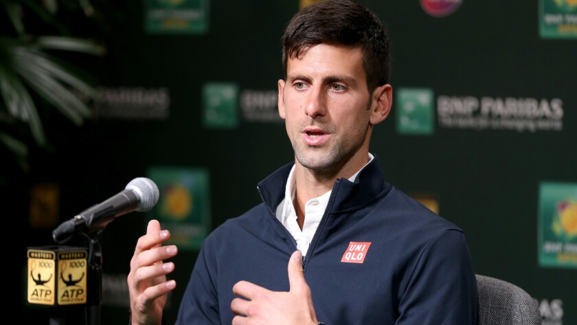 Novak Djokovic talks to reporters during a news conference Thursday at the BNP Paribas Open in Indian Wells.