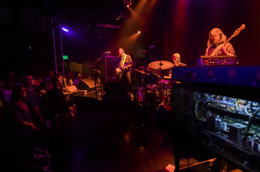 Sturgill Simpson, from left, performs at the Troubadour with drummer Miles Miller and bassist Chuck Bartels.