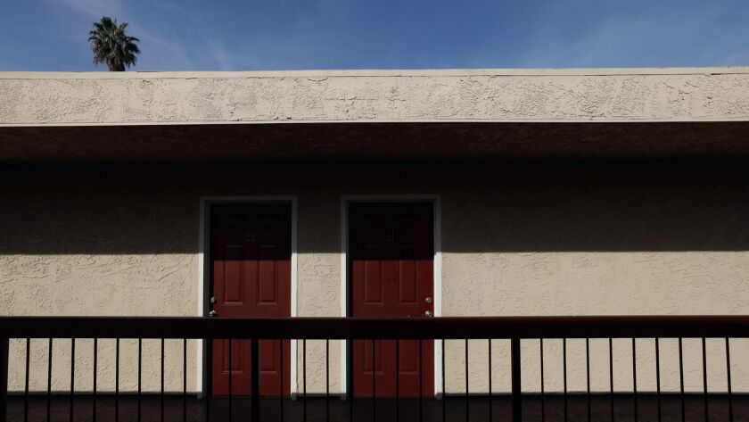 A former motel in South Los Angeles is temporarily being used to house homeless women.