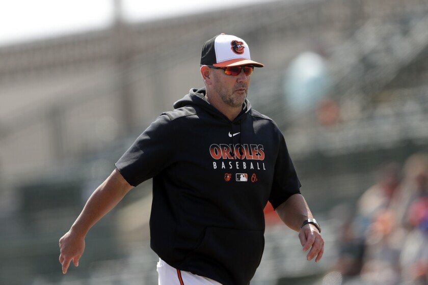 FILE - In this Tuesday, Feb. 25, 2020, file photo, Baltimore Orioles manager Brandon Hyde returns to the dugout after making a pitching changer during a spring training baseball game against the Tampa Bay Rays, in Sarasota, Fla. (AP Photo/John Bazemore, File)