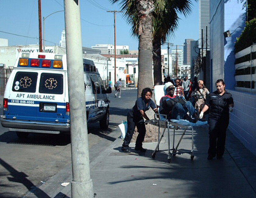 In this 2006 file photo provided by Los Angeles police, ambulance workers drop off a patient on skid row, even though police reports indicated he wanted to be taken to his residence at a Pasadena convalescent home.