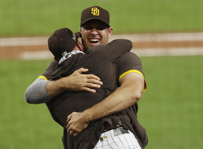 Pitcher Craig Stammen and manager Jayce Tingler celebrate winning the NL Wild Card Series at Petco Park.