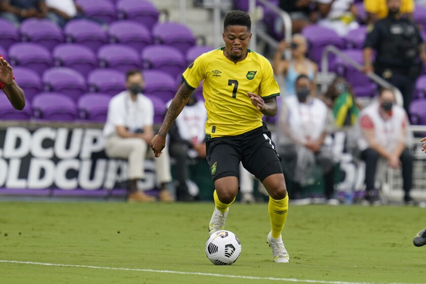 FILE - In this file photo dated Monday, July 12, 2021, Jamaica forward Leon Bailey moves the ball against Suriname during the first half of a CONCACAF Gold Cup Group C soccer match, in Orlando, USA. English Premier League team Aston Villa has announced Saturday July 31, 2021, an agreement to sign winger Leon Bailey from German club Bayer Leverkusen. (AP Photo/John Raoux, FILE)