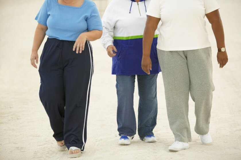 The risk of dying and of living with health complications may have more to do with where a person carries his or her fat than with how much fat a person carries, says a new study.