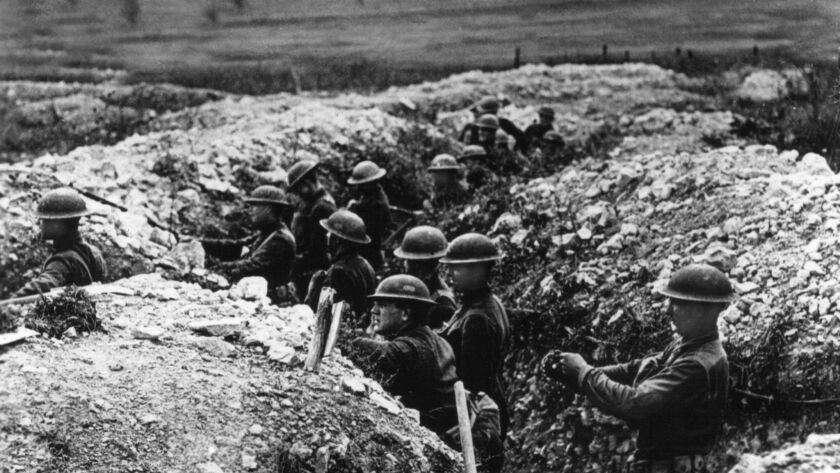 United States Army troops stand in the trenches in France during World War I.
