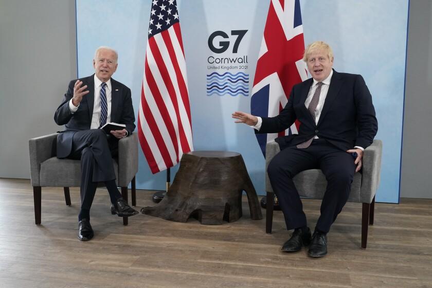 British Prime Minister Boris Johnson listens to U.S. President Joe Biden in April.