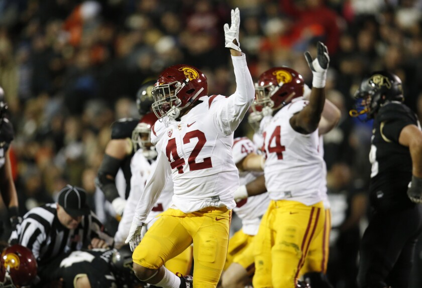 USC linebacker Uchenna Nwosu (42) signals after the Trojans recover a fumble by Colorado running back Christian Powell during a game on Nov. 13.