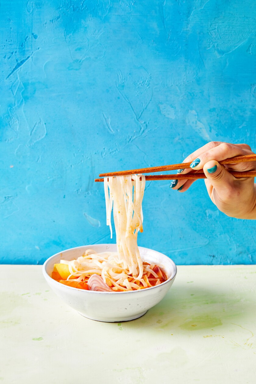 Rice noodles in a red curry broth.