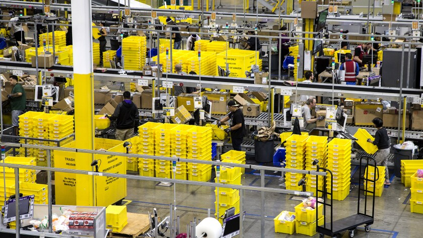 The Amazon Fulfillment Center bustles with activity on Cyber Monday