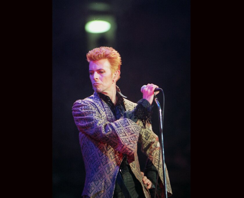 David Bowie performs during a concert celebrating his 50th birthday, at Madison Square Garden in New York, Jan. 9, 1997. Bowie, the innovative and iconic singer whose illustrious career lasted five decades, died Monday, Jan. 11, 2016, after battling cancer for 18 months. He was 69. (AP Photo/Ron Frehm, File)