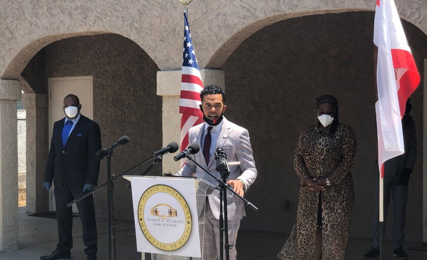 Civil Rights activist Shane Harris, flanked by other Black community advocates, advocates for reforms on June 22.