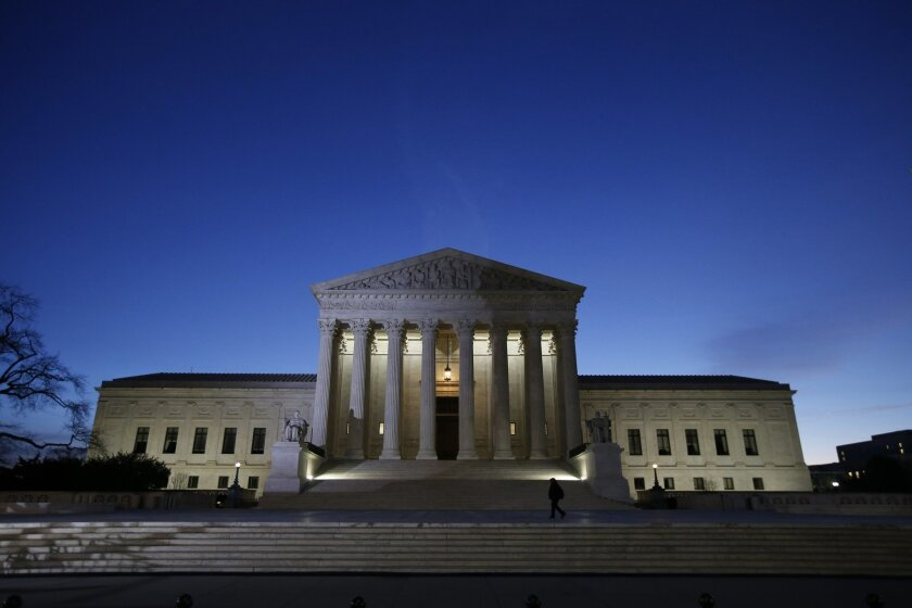 FILE - This Feb. 19, 2016 file photo shows the front of the U.S. Supreme Court building in Washington. It's business as usual at the Supreme Court this week, no matter that confirmation politics is on everyone's mind in Washington. (AP Photo/Alex Brandon, File)
