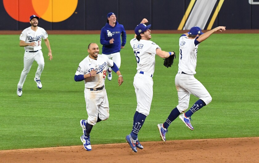 Dodgers players celebrate beating the Rays in Game 6 of the World Series on Oct. 27, 2020, to capture the title.