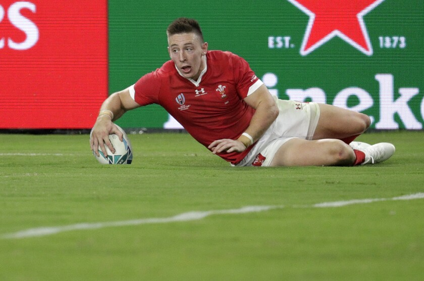Wales' Josh Adams scores his second try during the Rugby World Cup Pool D game at Oita Stadium between Wales and Fiji in Oita, Japan, Wednesday, Oct. 9, 2019. (AP Photo/Aaron Favila)