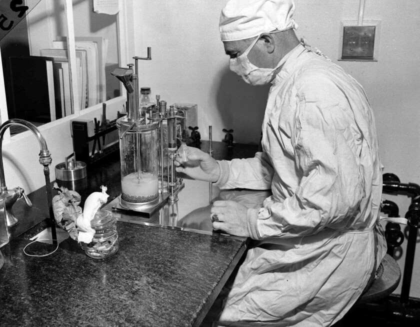 Filling a vial with vaccine