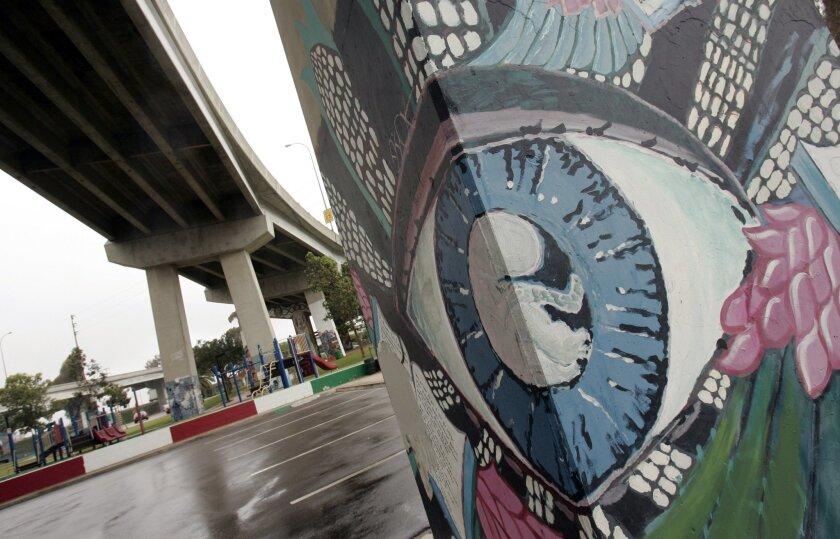 Artists use the pylons beneath the San Diego-Coronado Bridge as the canvasses for their murals. JOHN GASTALDO • U-T photos