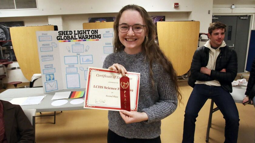 Erin Buchanan, a 11th grader at La Canada High School, is all smiles winning second place for her sc
