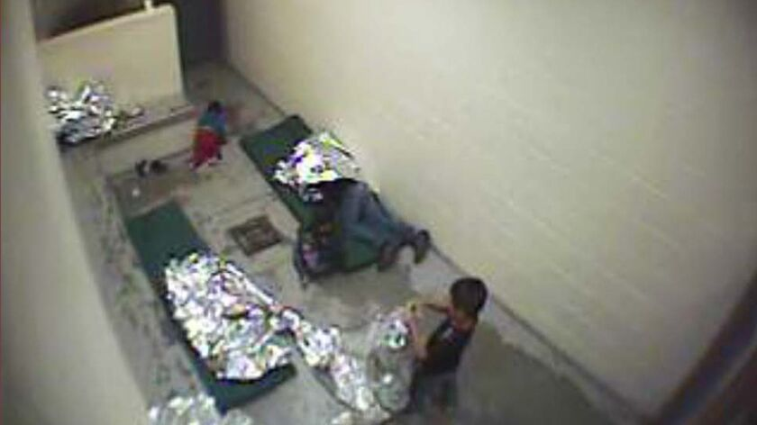 This September 2015 image made from U.S. Border Patrol surveillance video shows a child crawling on