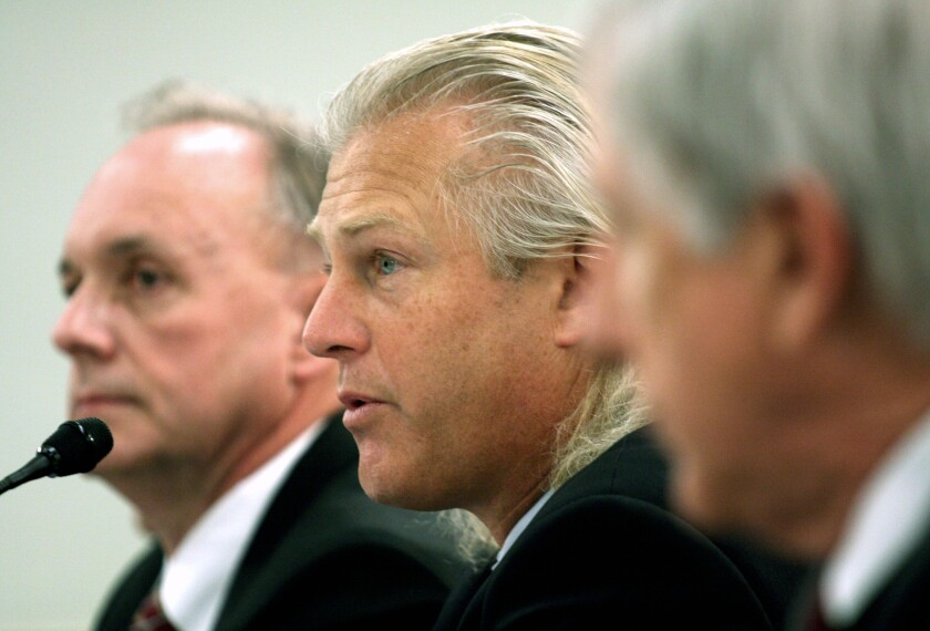 Bumble Bee Foods President and Chief Executive Officer Christopher Lischewski, center, in 2008 on  Capitol Hill.