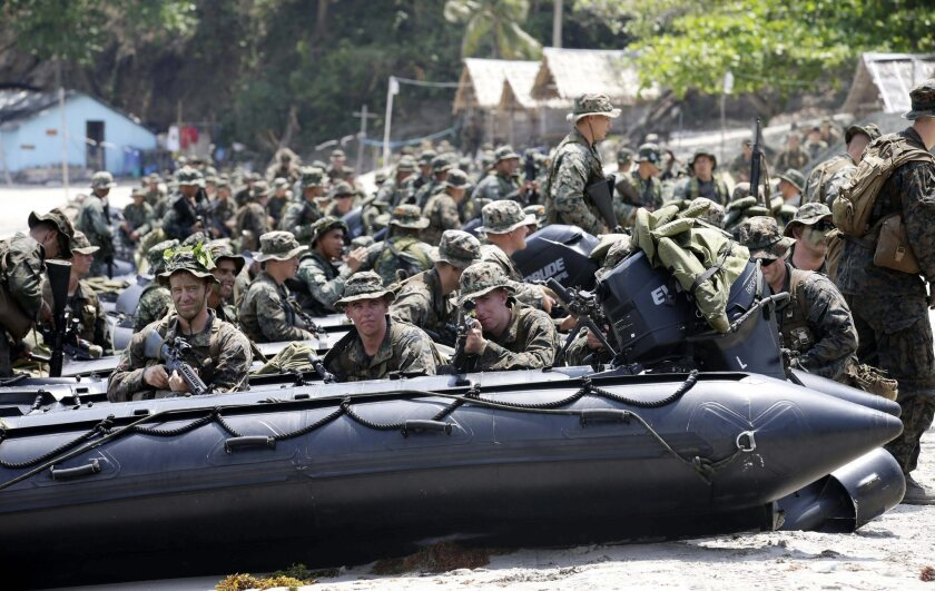 Filipino Marines and U.S. troops simulated an amphibious assault on an unspecified hostile area during a joint military exercise held at the Philippines Marine Base in Tarnate last week. Rival claims of sovereignty over islands and fishing grounds in the South China Sea have strained relations between Asian powerhouses and small states, and the conflict is expected to figure high on the agenda at Wednesday's summit of the Assn. of Southeast Asian Nations in Brunei.