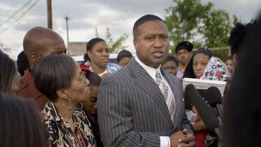 Quanell X speaks at a candlelight vigil in Houston for a 13-year-old girl who was killed in a drive-by shooting in 2007.