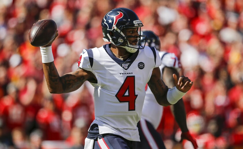Houston Texans quarterback Deshaun Watson throws a pass during the first quarter against the Kansas City Chiefs on Sunday.
