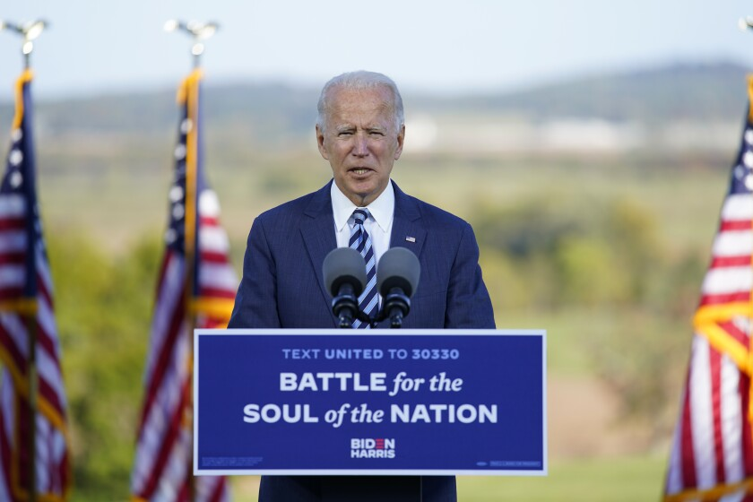 Joe Biden speaks at a podium outside Gettysburg National Military Park.