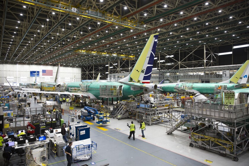 Employees work on 737 Max airplanes at the Boeing factory in March 2019.
