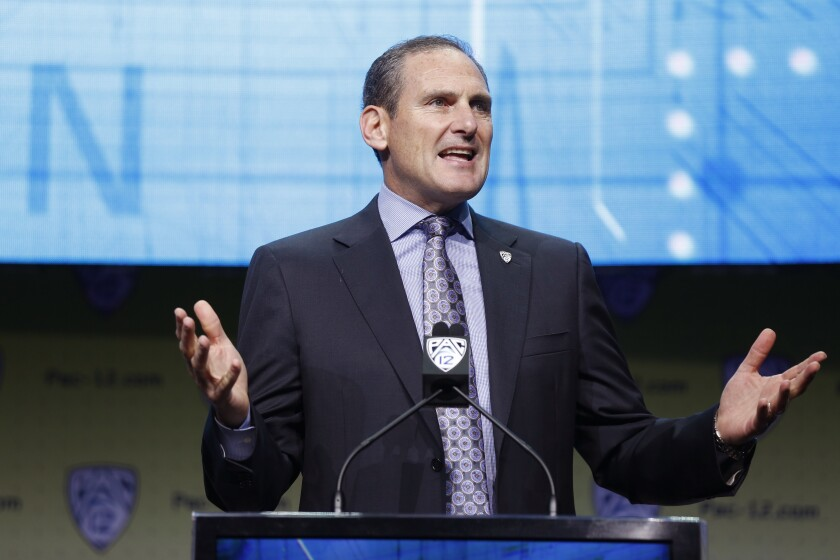 Pac-12 Commissioner Larry Scott speaks at a conference.