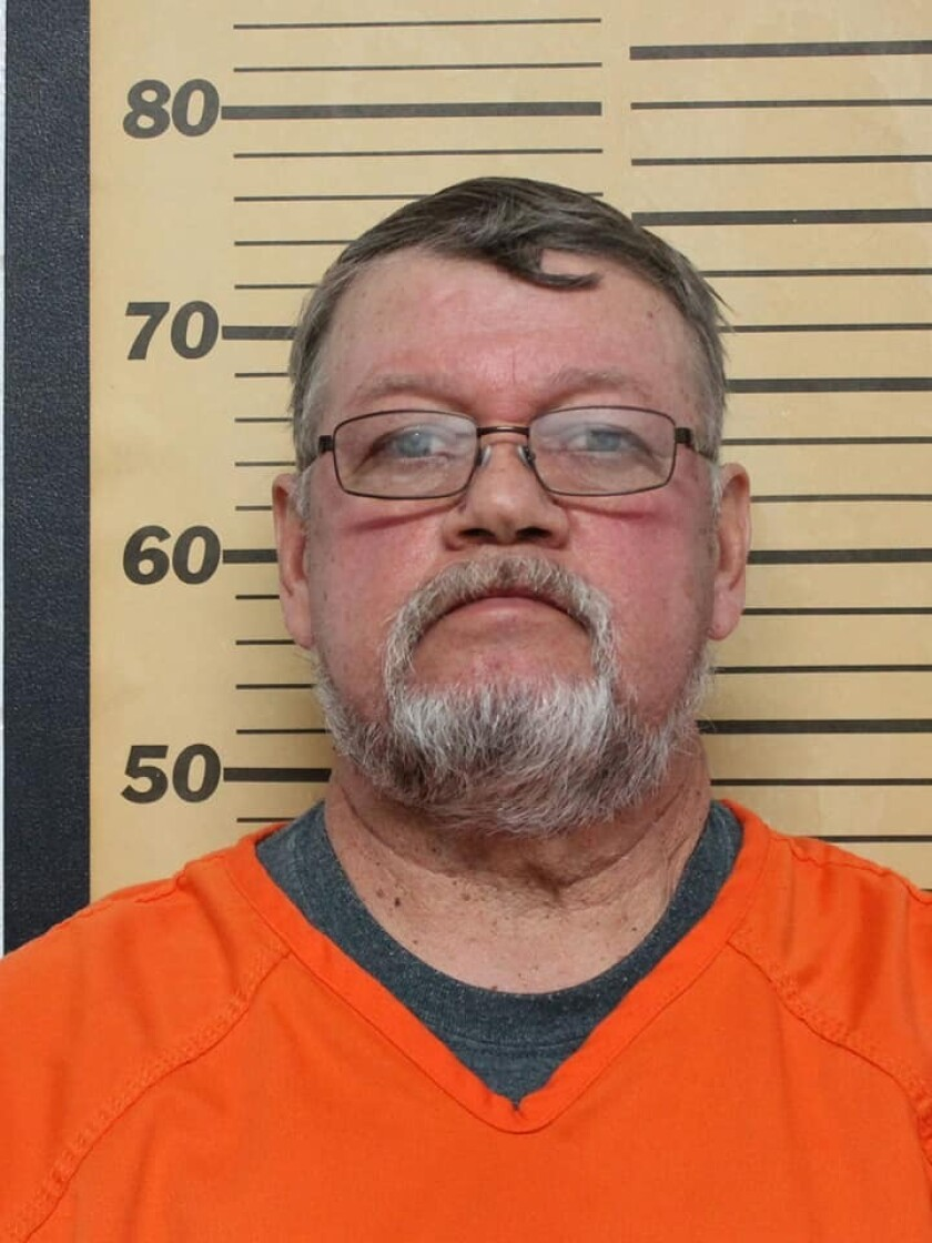 """This photo provided by Emmet County Sheriffs Office shows Greg Buum. The Emmett County Sheriff's Office announced Friday, Feb. 12, 2021, in a news release posted on Facebook that the Iowa Attorney General's Office filed the charges against Armstrong Mayor Greg Buum, police chief Craig Merrill, city clerk Tracie Lang and former city clerk Connie Thackery on Thursday. The sheriff's office said the investigation uncovered """"misappropriation of city funds, the presentation of fraudulent public records, deploying a TASER against a civilian in exchange for cash, and falsification of ledgers to conceal embezzlement."""" (Emmet County Sheriffs Office via AP)"""