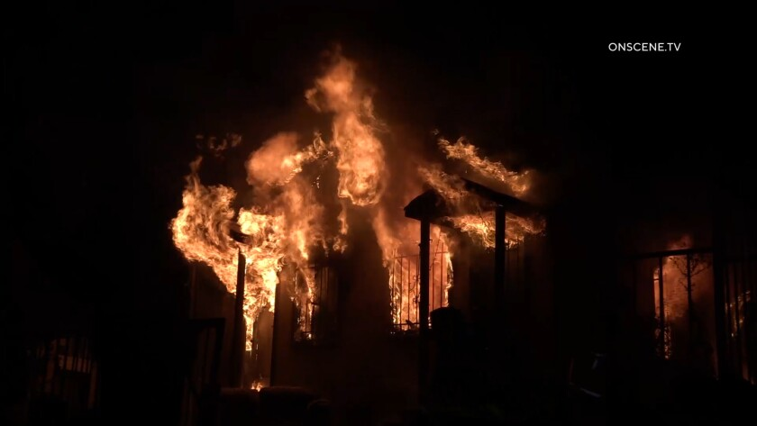 Two people died and three others were hospitalized after a fire ripped through a Logan Heights home on Clay Avenue.