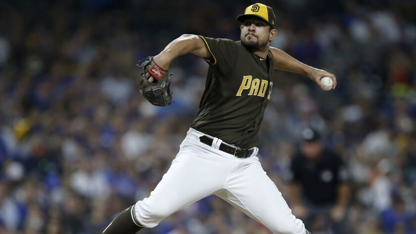 San Diego Padres relief pitcher Brad Hand delivers to a Chicago Cubs batter during the ninth inning