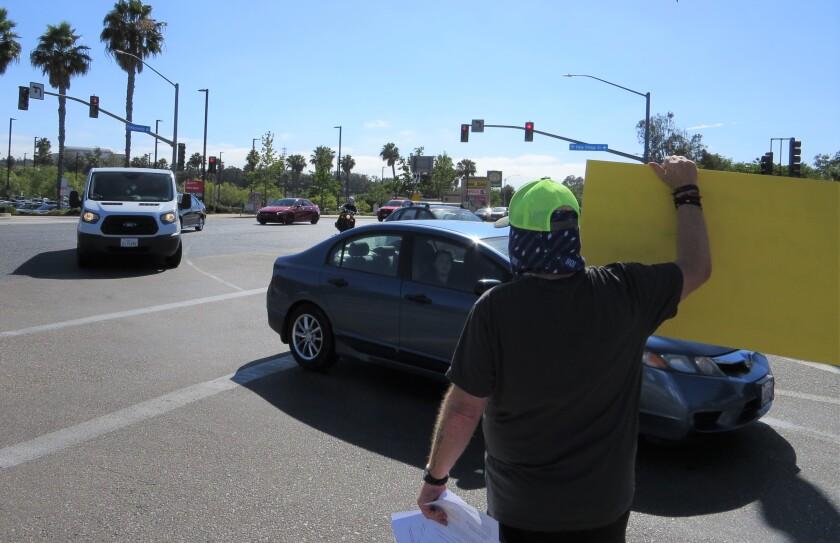 David Greenspan protests against Sunroad Plaza in Vista